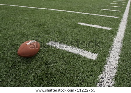 Football near the hashmarks - stock photo