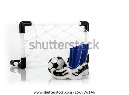 Football Net with boots and ball - stock photo
