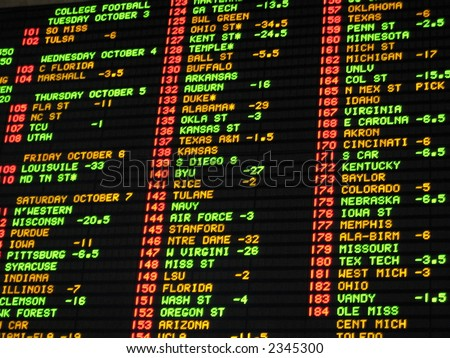 Football odds betting board at a las vegas casino sportsbook - stock photo