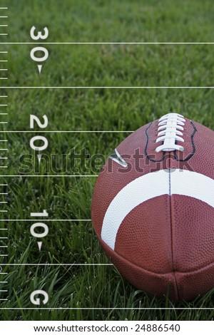 Football on a field - stock photo