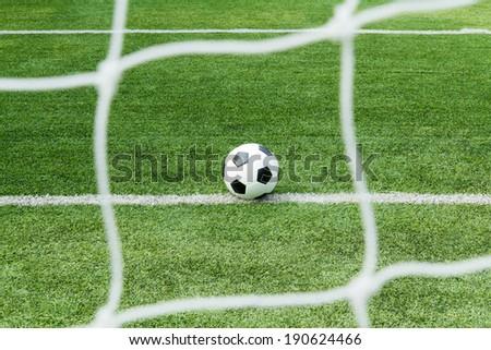 Football on goal line, goal or no goal - stock photo