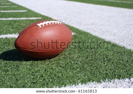 Football on the sideline - stock photo