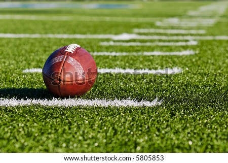 Football on Yardage Marker. Low Angle. Horizontal View - stock photo