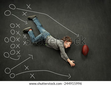 Football playbook with boy diving for the catch
