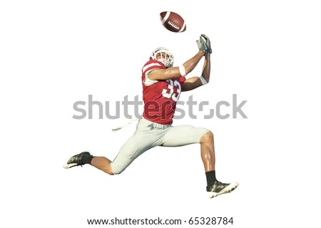 football player catches ball in midair - stock photo