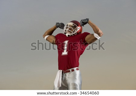 Football player celebrates victory - stock photo