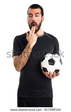 Football player doing vomiting gesture - stock photo
