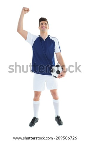 Football player in blue celebrating on white background