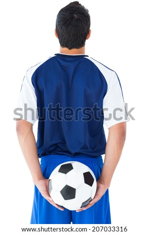 Football player in blue holding the ball on white background - stock photo