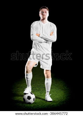 football player in white unform on grass field. Sport portrait.