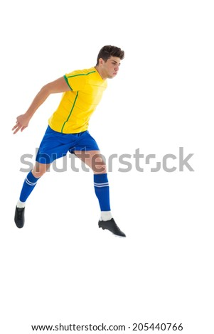 Football player in yellow jumping on white background - stock photo