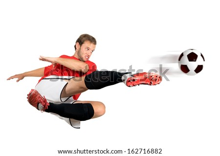 Football player kicking a ball isolated in white - stock photo