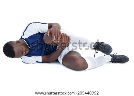 Football player lying down injured on white background - stock photo