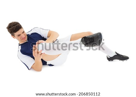 Football player lying down injured on white background