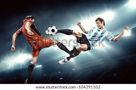 Football player makes injury to an opponent. Not fair play. - stock photo