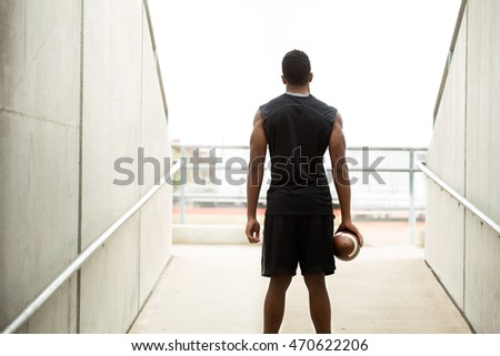 Football player mentally preparing for the game.  Goal and focus concepts.