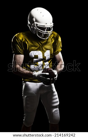 Football Player on a yellow uniform, on a black background.