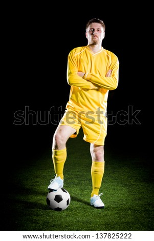 football player on grass field. Sport portrait. - stock photo