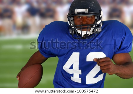 Football player playing in a game on field - stock photo