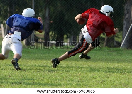 Football Player running towards a touchdown - stock photo
