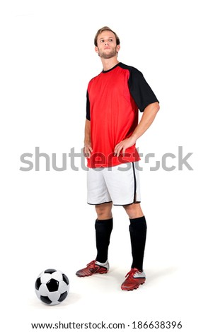 Football player waiting for a free kick isolated in white - stock photo