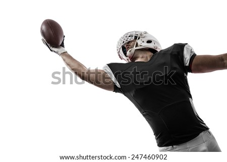 Football Player with a black uniform making a catching on a white background. - stock photo