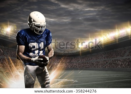 Football Player with a blue uniform on a stadium.