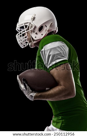 Football Player with a Green uniform Running on a black background.