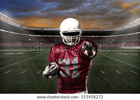Football Player with a Red uniform celebrating with the fans. - stock photo