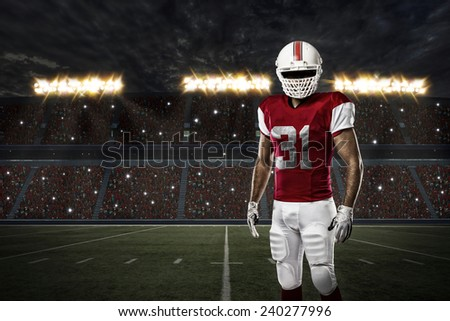 Football Player with a red uniform on a stadium. - stock photo