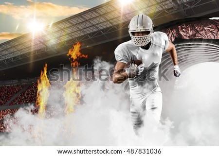 Football Player with a White uniform coming out of a stadium tunnel.