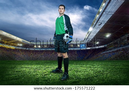 Football player with ball on field of stadium - stock photo