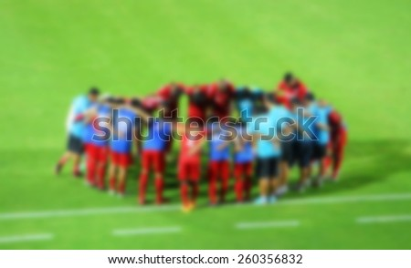 football players and staff to encourage before the game (blur effect photo)  - stock photo
