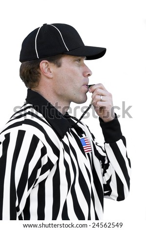 Football Referee Blowing Whistle - stock photo