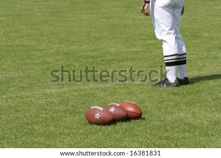 Football referee standing on the grass, focus in balls - stock photo