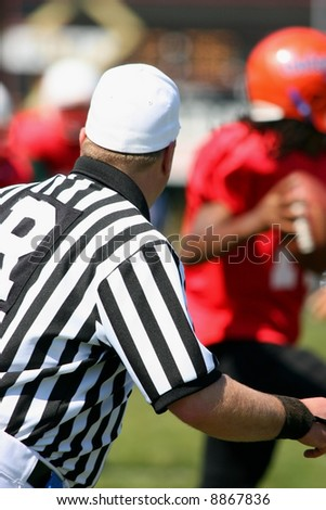 FOOTBALL REFEREE WATCHING THE PLAY - stock photo