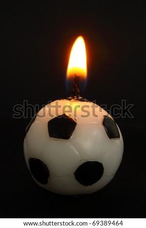 football shaped candle - stock photo