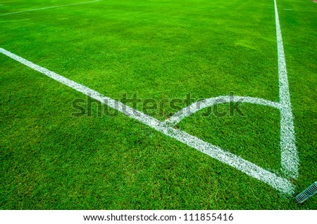 Football (soccer) field corner with white marks - stock photo