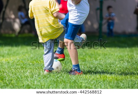 Football soccer match for children, kids playing soccer game  - stock photo