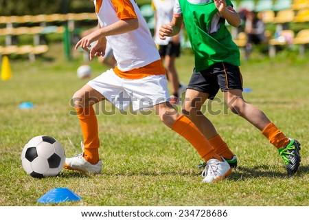 Football soccer match for children. kids playing soccer game tournament - stock photo