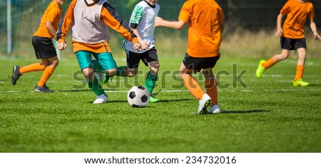 Football soccer match for children. kids playing soccer game tournament. physical education classes at school. - stock photo