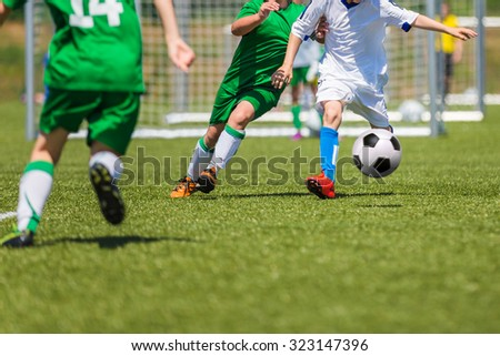 Football soccer match for children. Training and football soccer tournament. Boys playing football game.  - stock photo