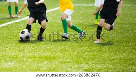 Football soccer training match for children. Boys playing football  - stock photo