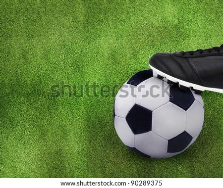 Football sport, kid playing soccerand holding soccer ball. - stock photo