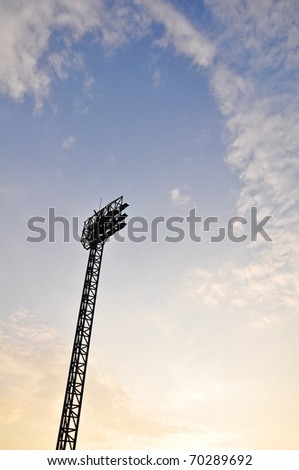 Football Stadium Floodlights with cloud and evening sky