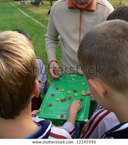 Football strategy before game. - stock photo