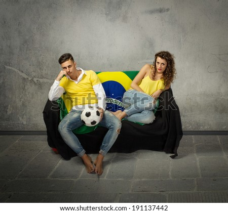 football supporters desperation on a sofa - stock photo