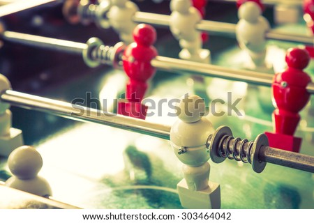 Football table game with red and white player ( Filtered image processed vintage effect. ) - stock photo