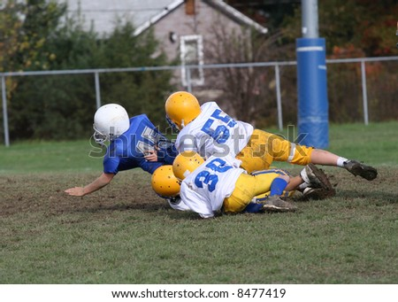 Football Tackle in Endzone - stock photo