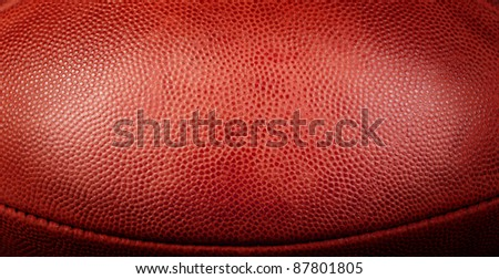 football texture with bottom seam showing and center spotlight - stock photo